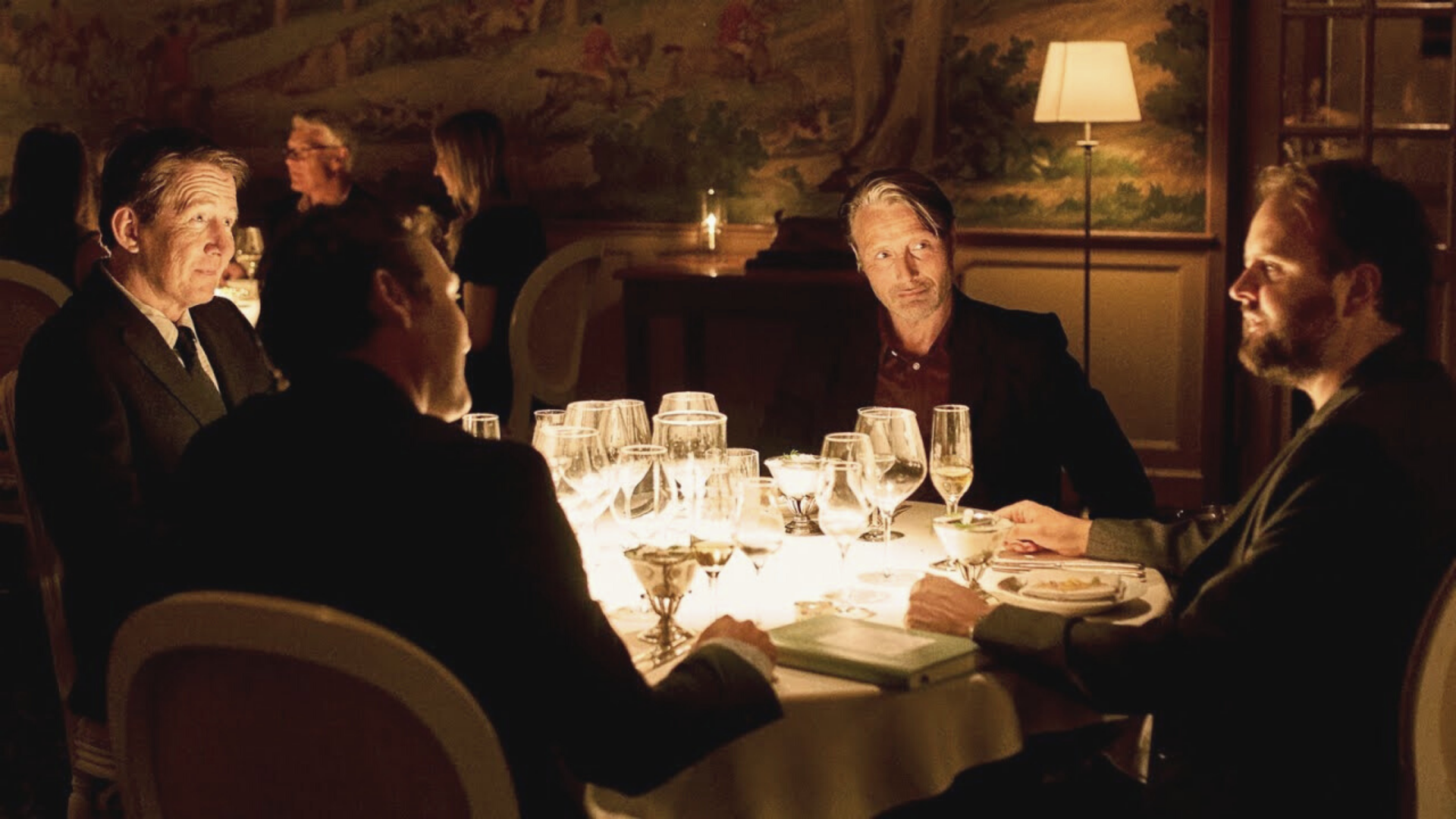 Another Round-the friends at dinner. With Thomas Bo Larsen as Tommy, Mads Mikkelsen as Martin, Magnus Millang as Nicolaj, and Lars Ranthe as Peter
