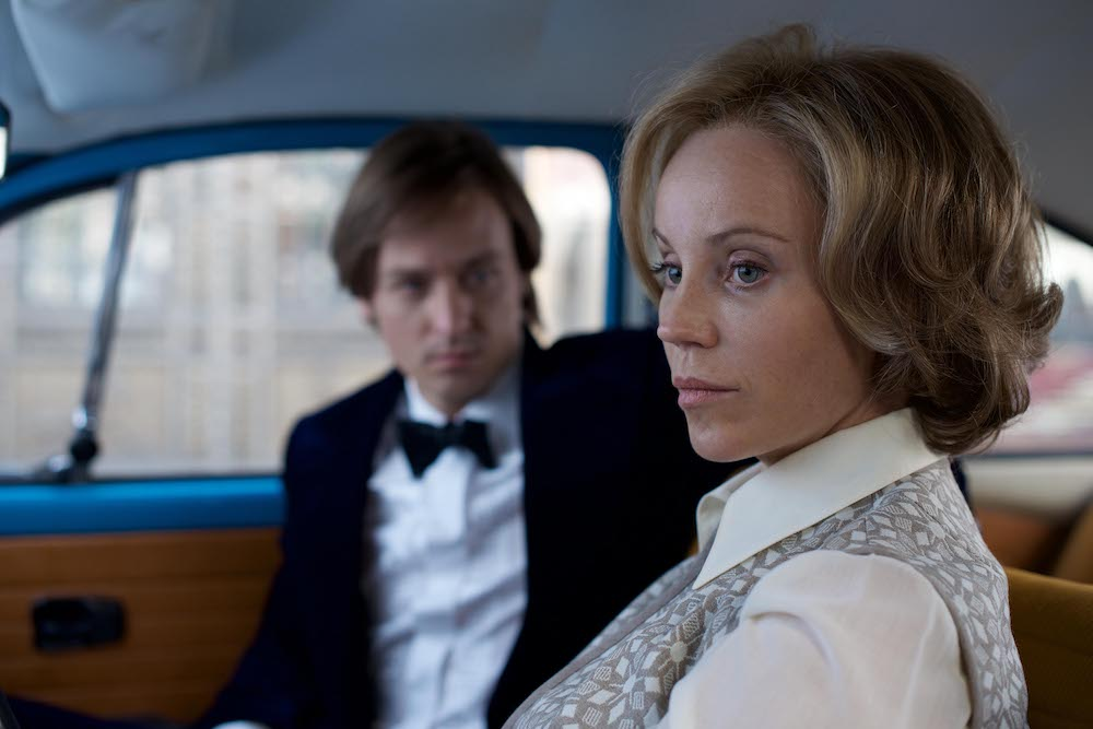 The Same Sky Scene of Tom Schilling as Lars Weber in the car with Sofia Helin as Laren Faber